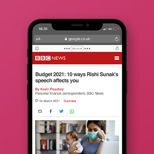 Mockup of an iPhone showing a news article from BBC News titled 'Budget 2021 10 Ways Rishi Sunak's speech affects you'